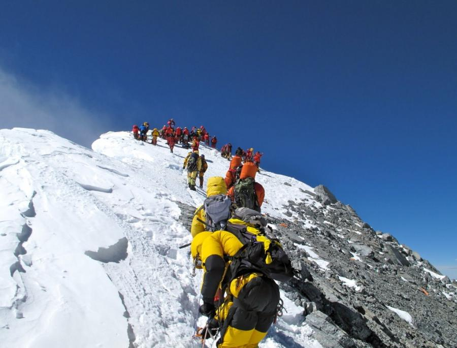 Crowd on the pool table-sized summit of Mt. Everest! Really!...