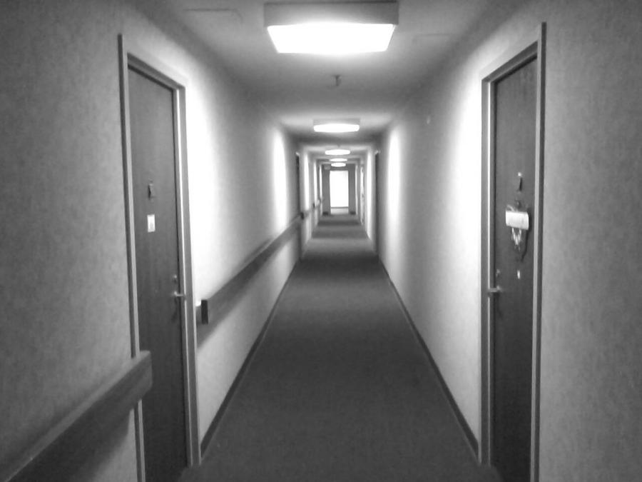 Black and white hallway with white lighting