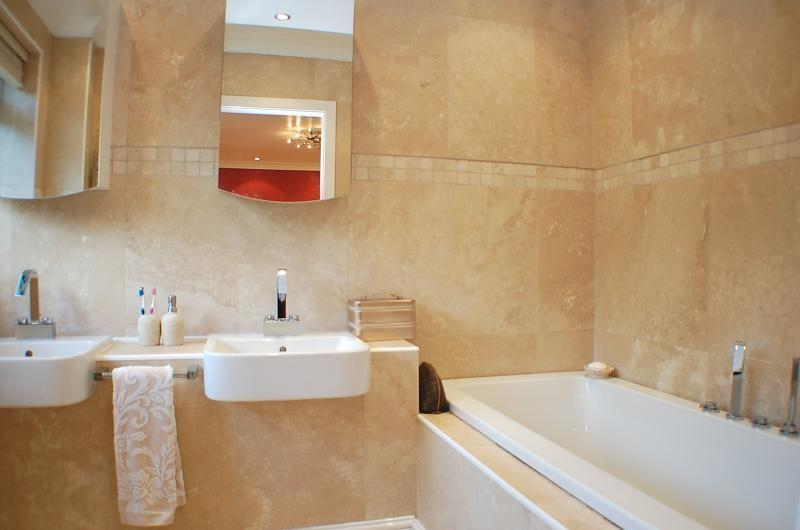 photo of modern stylish beige white marble bathroom with mirror...