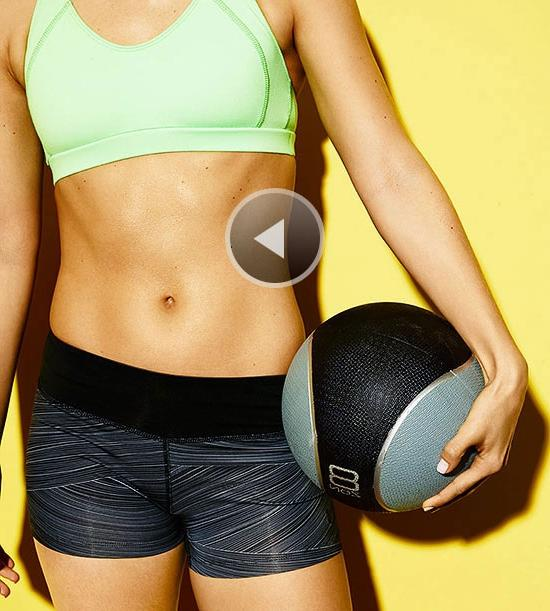 Woman holding exercise ball, flat abs