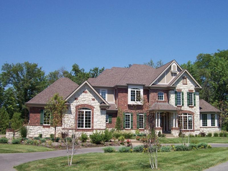 Photos of two story brick homes for Luxury brick house plans