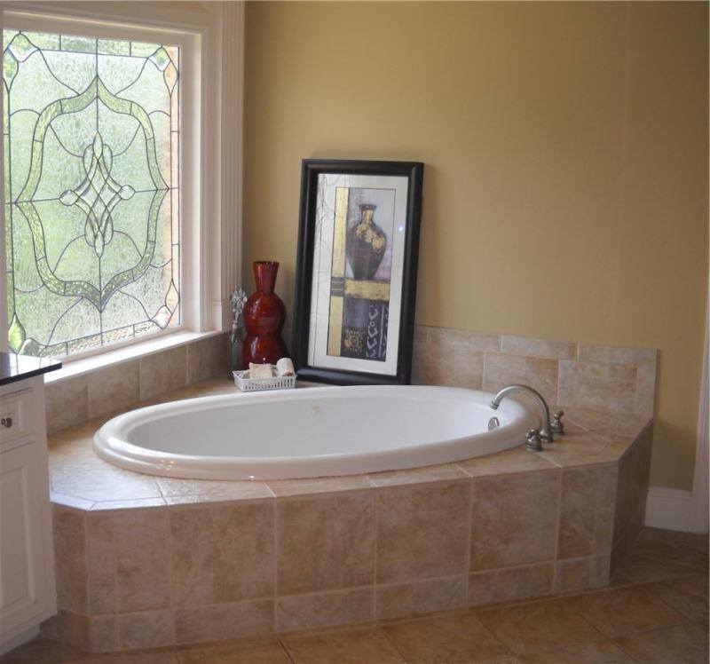Decorating around a bathtub the happier homemaker garden for How to decorate a garden tub bathroom