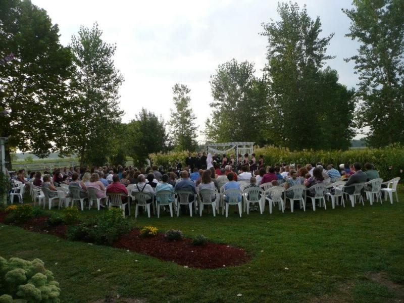 Country wedding held at Victorian Veranda Country Inn in...