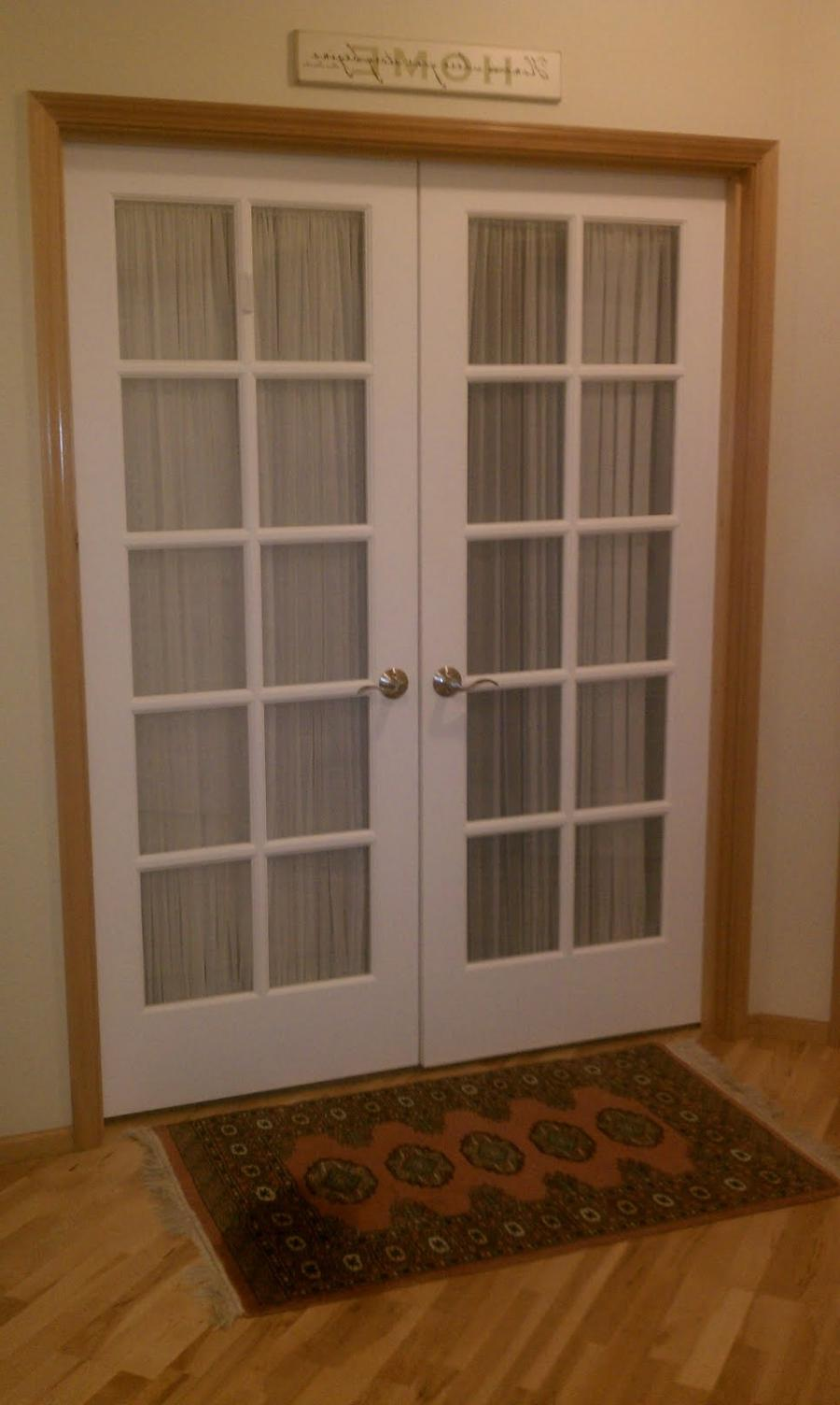 Enter off the foyer through double French doors. We added sheeer...