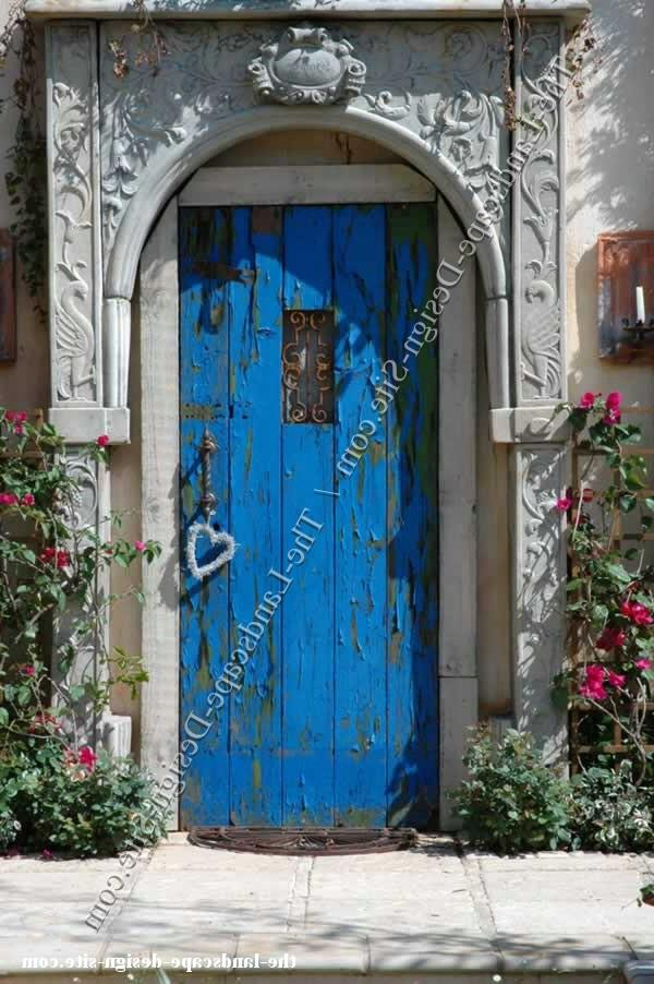 old blue painted door as rustic and antique garden decor