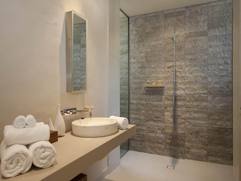 Exposed brick in a bathroom design from an Australian home -...