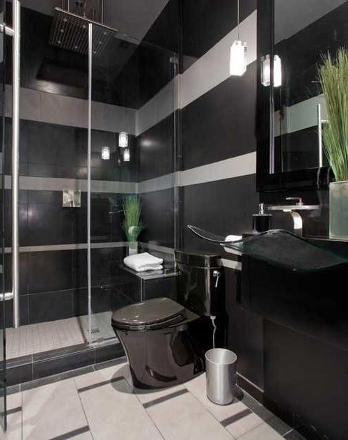 ... black bathroom toilet, sink and furniture with black wall...