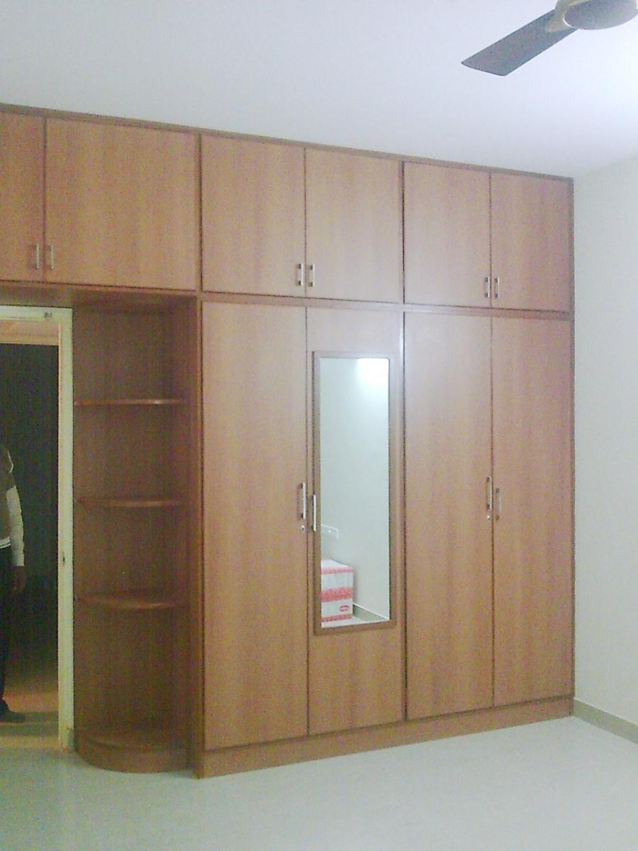 Photos of latest wardrobe designs in india for Bedroom wooden wardrobe designs india