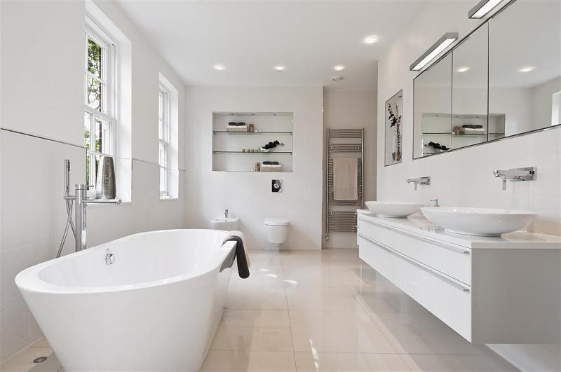 photo of contemporary minimalist modern white bathroom with...