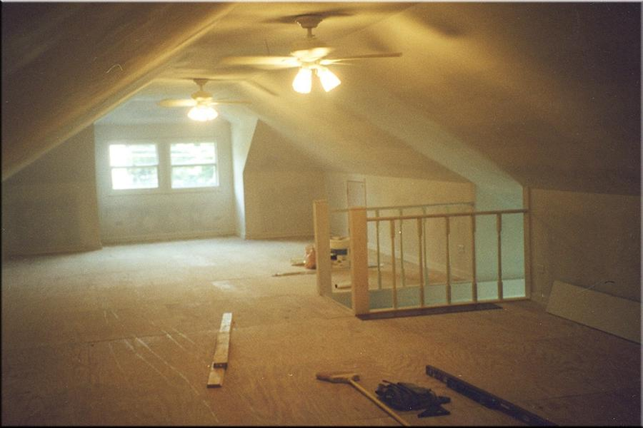 This is the attic after the remodeling project. The new stairway...