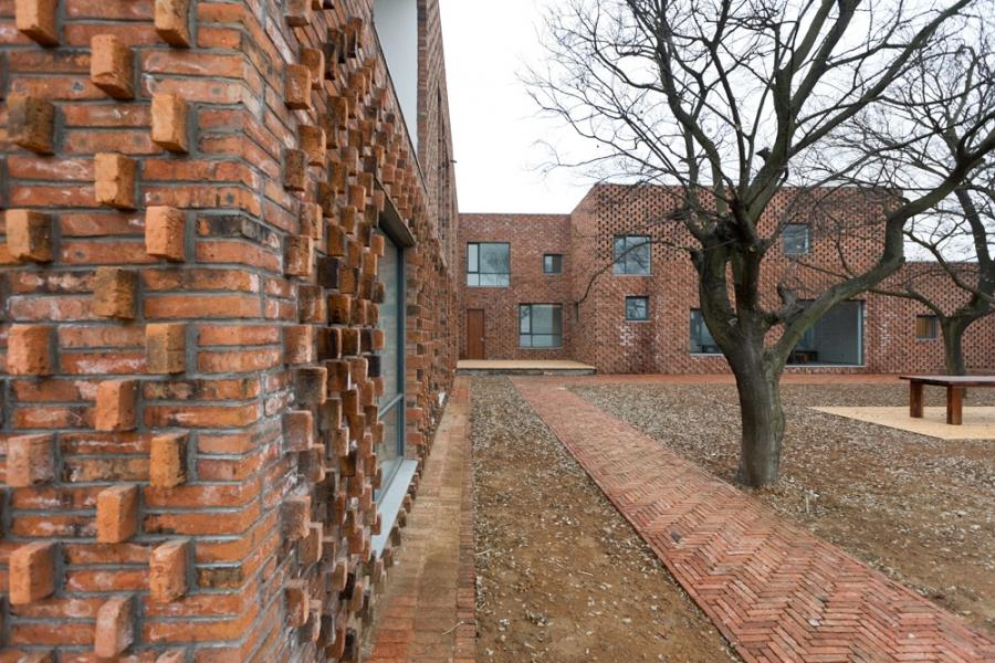 Concrete Brick Home Design With Courtyard Built By AZL Architect
