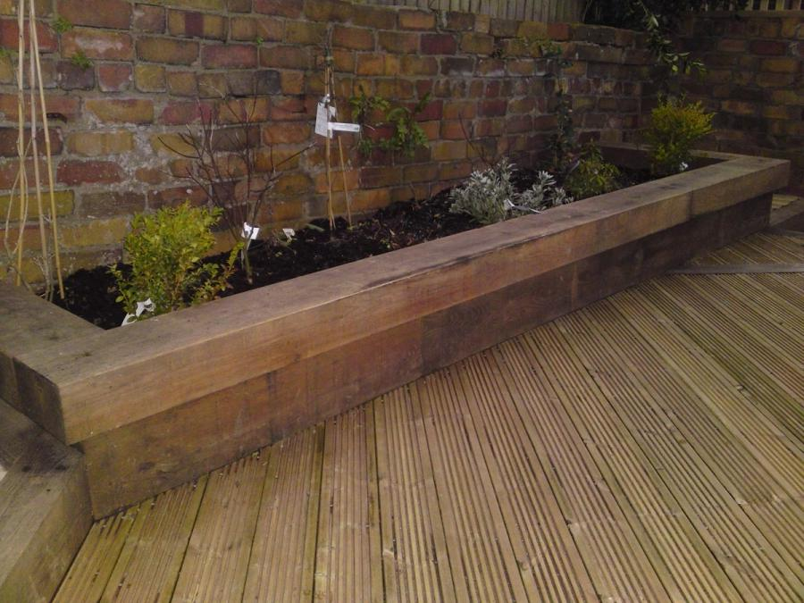 Photos of raised flower beds for Garden decking examples