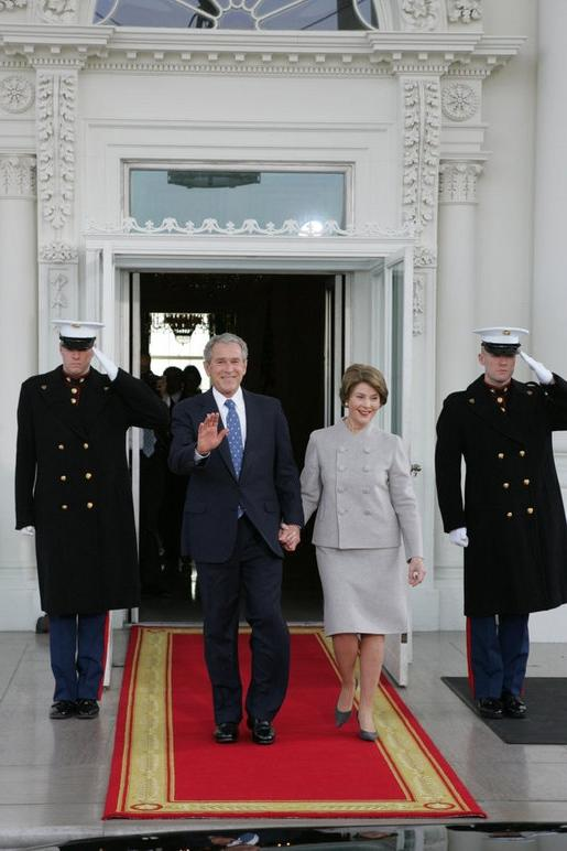 President George W. Bush and Mrs. Laura Bush walk out on the...
