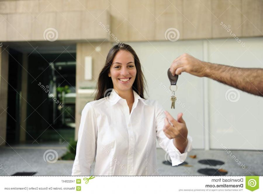 Owner of a new apartment: Woman receiving the keys