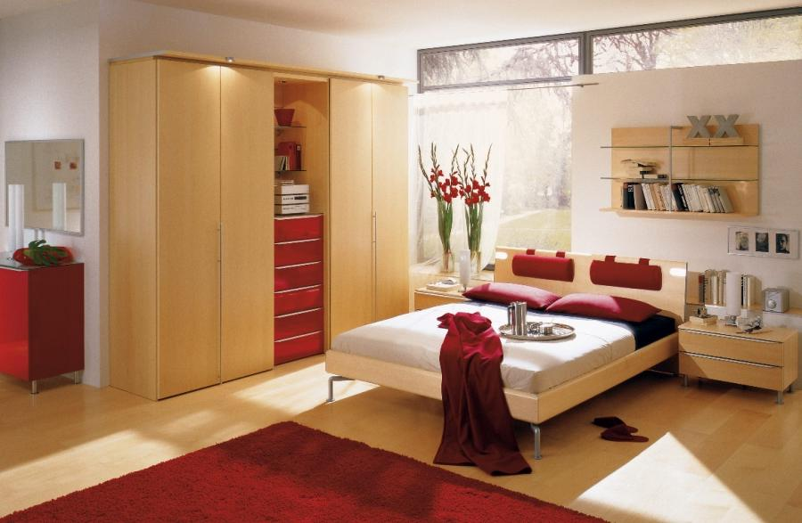 We admire the soft wood that permeates most of this red bedroom