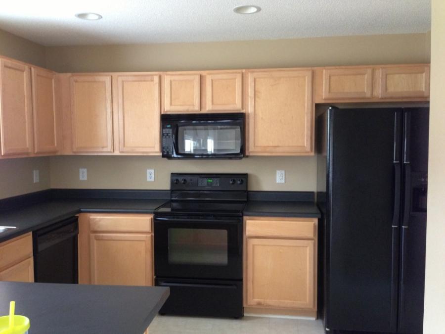 Beige kitchen cabinets photos for Beige kitchen cabinets