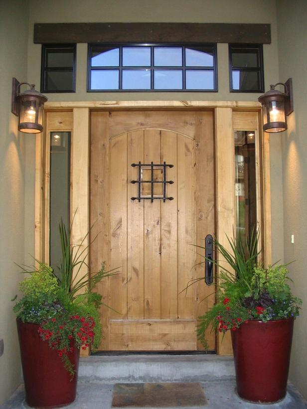 Wooden Door with Lantern Sconces