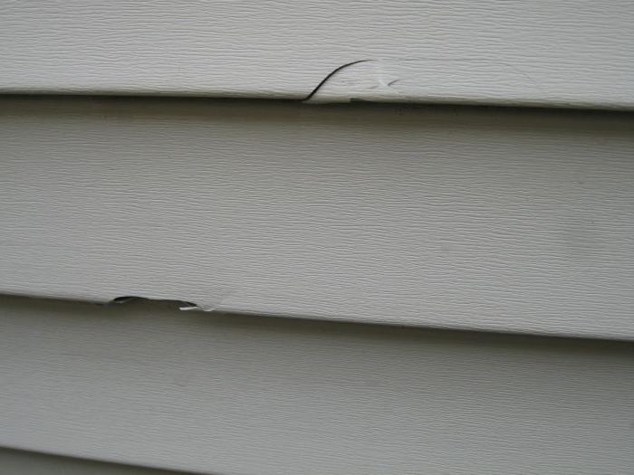 Photos of hail damage to aluminum siding for Hail damage vinyl siding