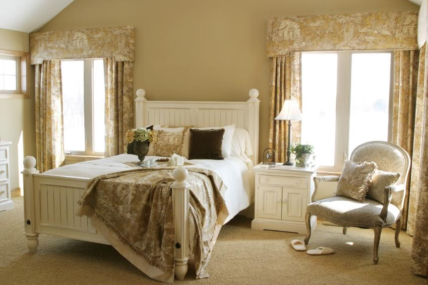 Here I love the shades of ivory with French white furniture.