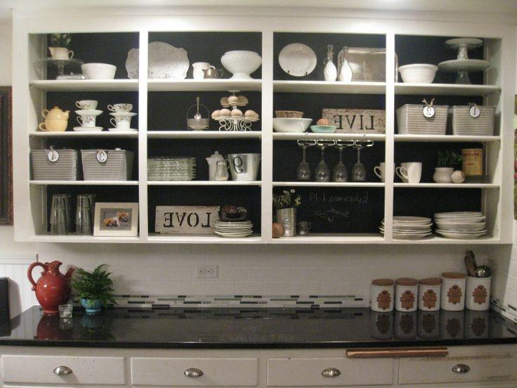 door less cabinets with chalkboard paint background - softens the...