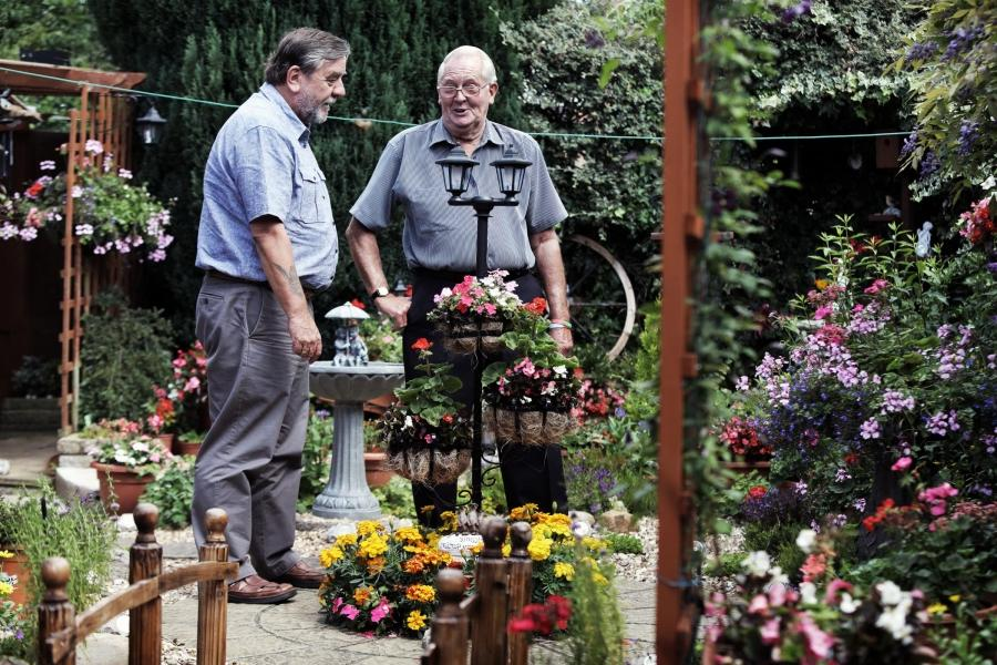 FLOWER POWER: Dennis Woodcock in his garden with Darlington...