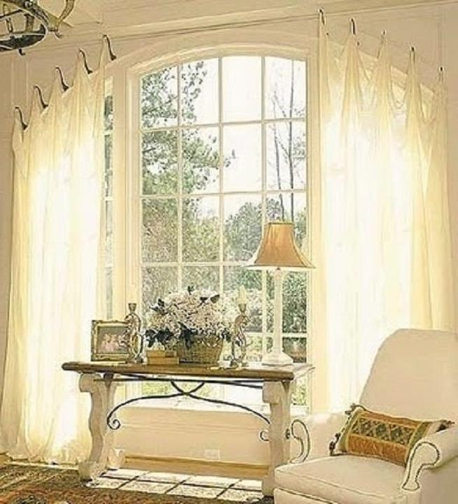 Photos of curtains on arched windows for Arched bay windows