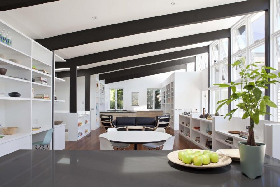 Sleek black ceiling beams draw attention to the homeu gorgeous...