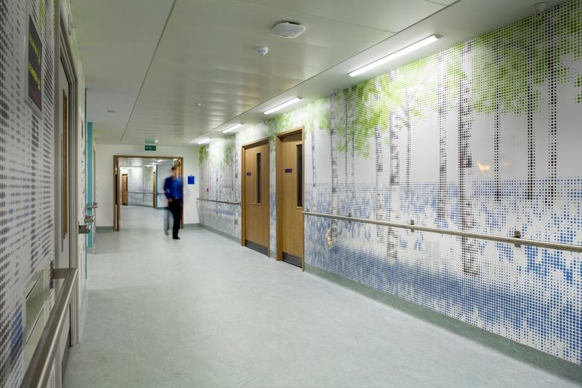 the integrated LED panels and bespoke graphic wallpaper line the...