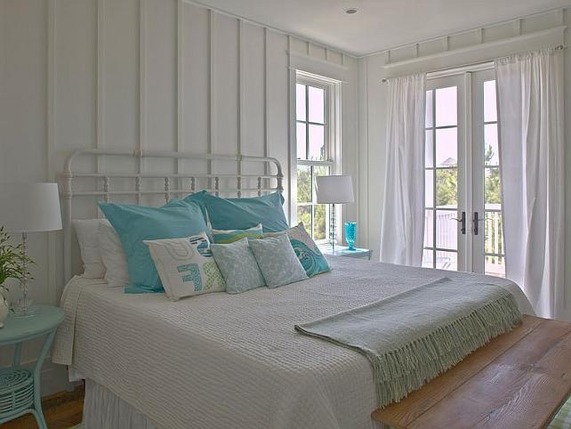 The master bedroom is very charming with its coastal decor....