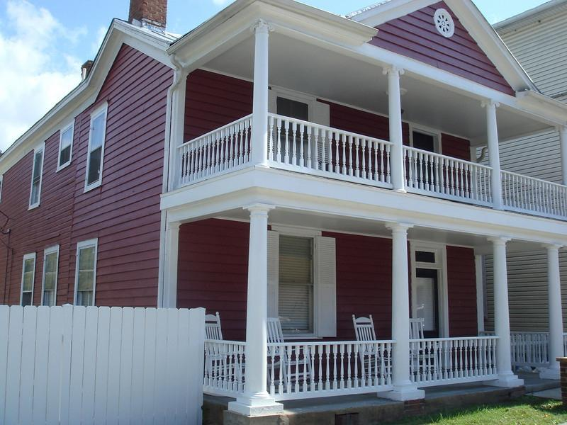 Large front porch and second story balcony.