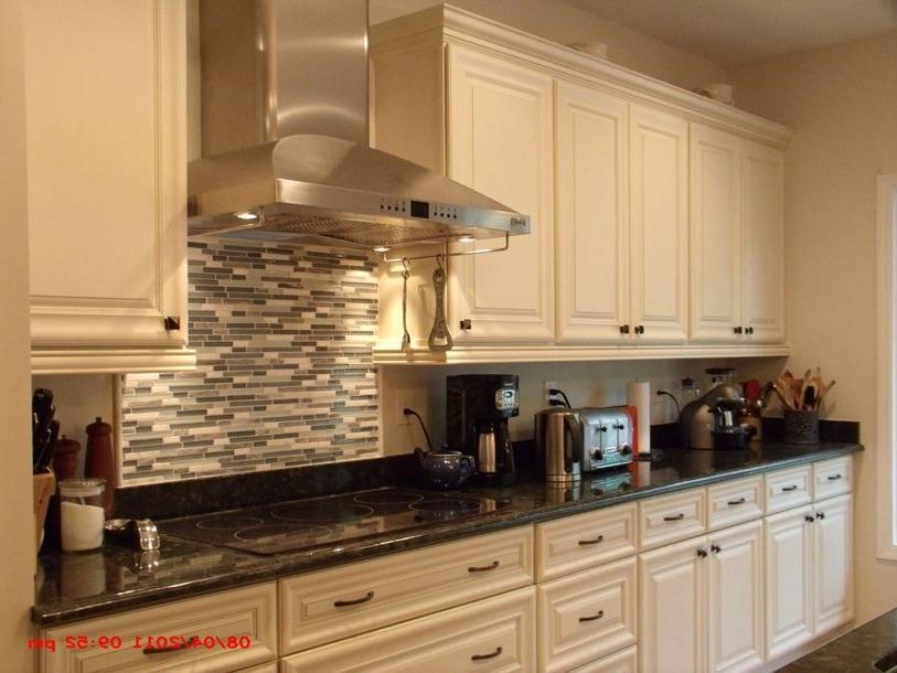 Creamy white kitchen cabinets photos