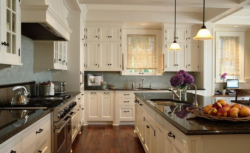 Gorgeous classic creamy kitchen with antique bronze hardware,...