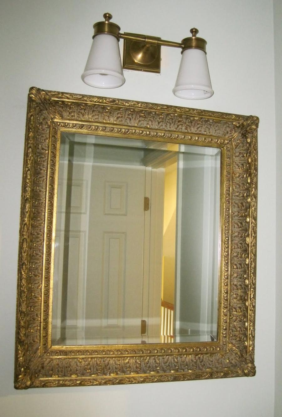 Finally, the builder-grade mirror was replaced by a lovely...