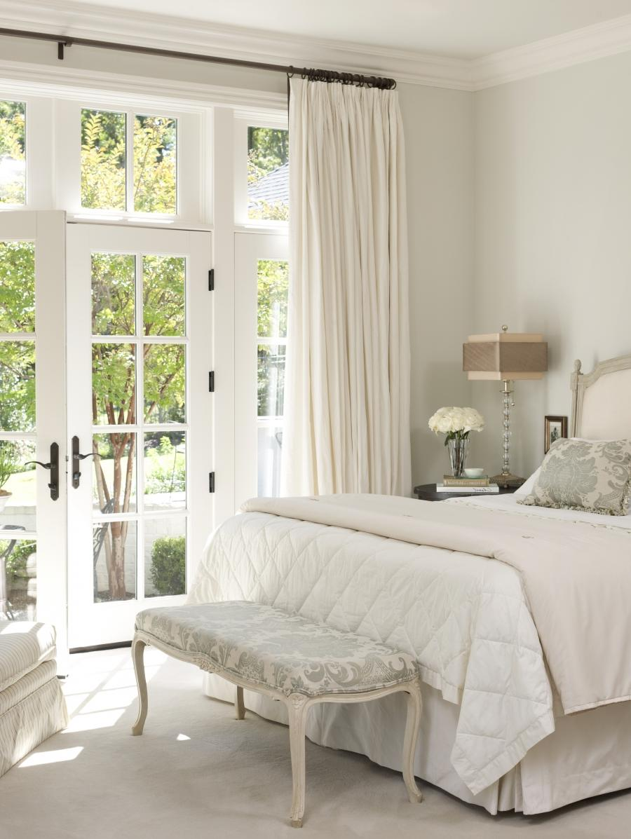In the master bedroom, French doors lead to the courtyard.