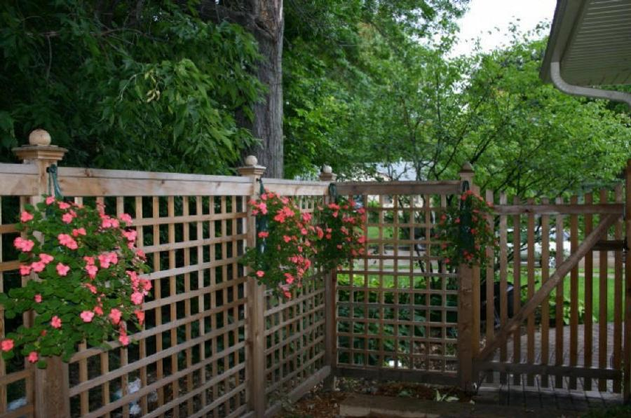 Lattice fence adds security and privacy to this backyard in N.E....