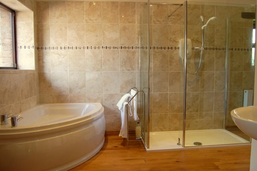 The private bathroom with bath and walk-in shower
