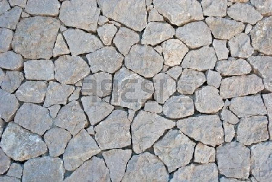 Stock Photo - surface texture of stone wall decoration