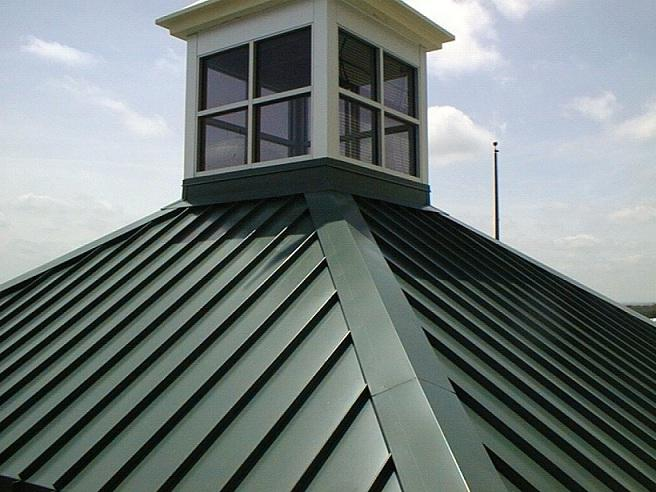 Metal roof oil canning photo for Metal hip roof