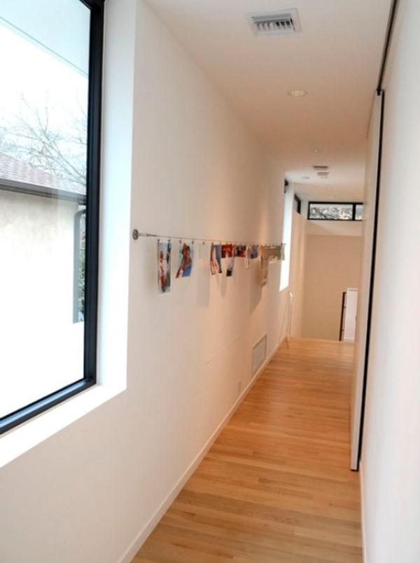 A novel way of hanging your hallway pictures is to install a...