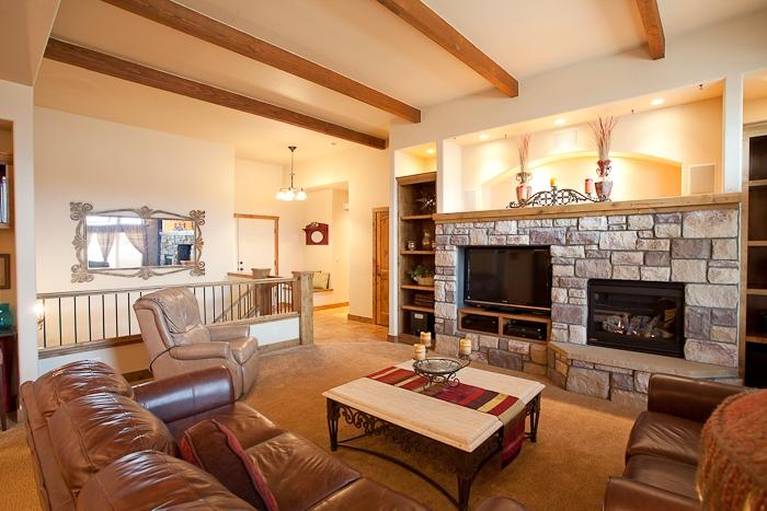 volume ceilings exposed beams and large stone fireplace exposed...
