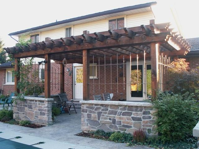 Wood Pergola with Stone Walls traditional-exterior