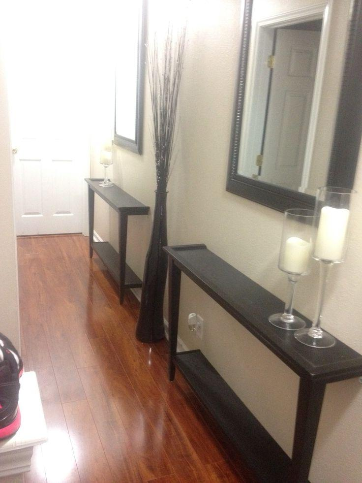 Narrow hallway decor solution! Cut a table in half and bolt to...