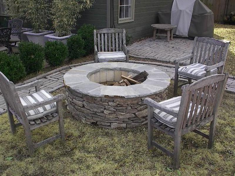 Outdoor Wood Burning Firepit Kit with natural stone veneer.