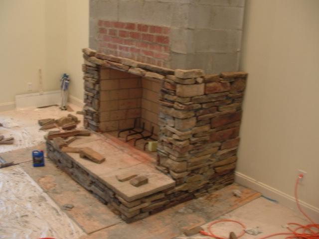 ... faux stacked stone fireplace ...