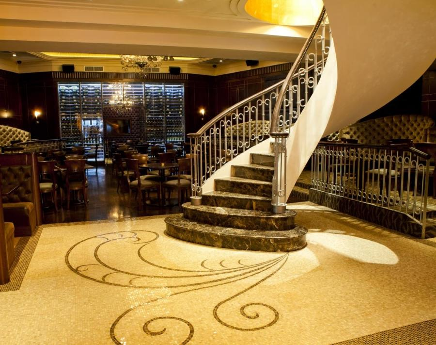 ... energetic lounge scene, power lunch spot and upscale dining...