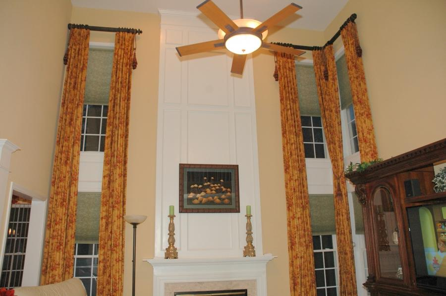 Photos of 2 story family rooms for 2 story family room window treatments