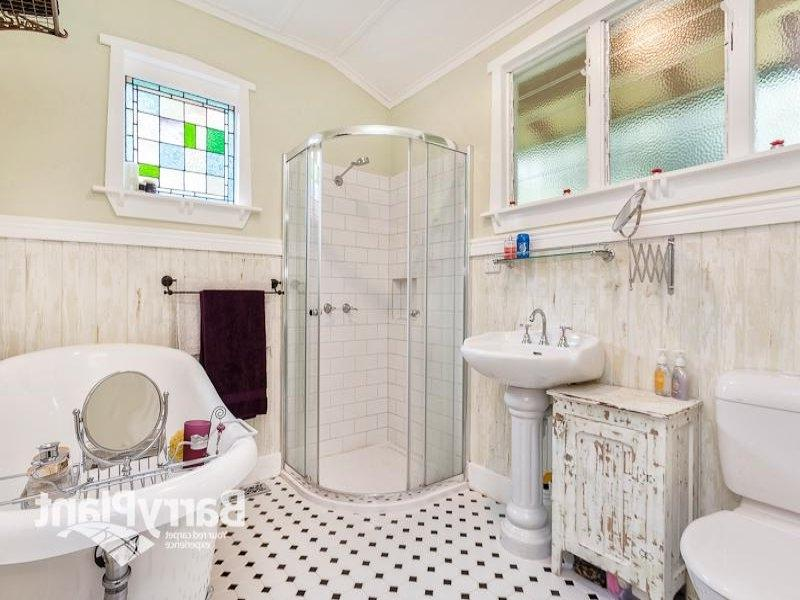 French provincial bathroom design with freestanding bath using...
