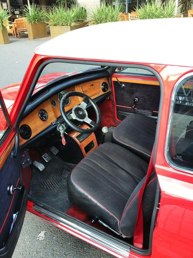 Here is our Austin Mini Cooper (1974) 1275 GT in Red. This Mini...