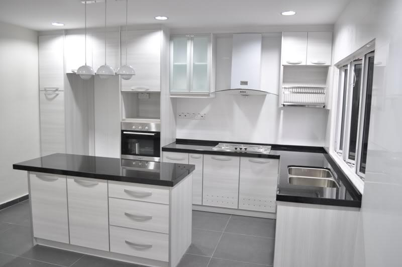 Above picture is a White Colour L-Shaped Kitchen Design with...