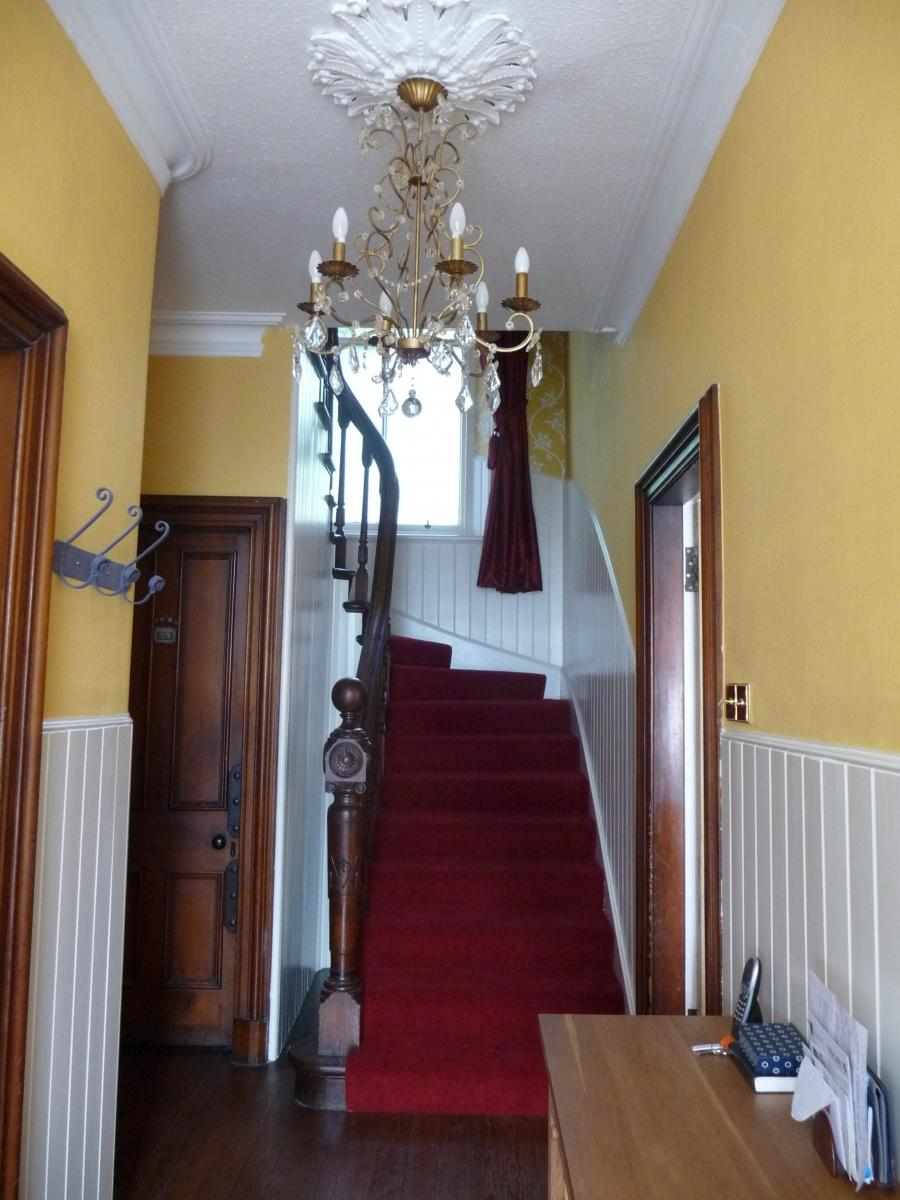 Photograph of hallway, landing  stairs decorated by Steve